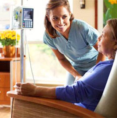 health staff talking to senior patient